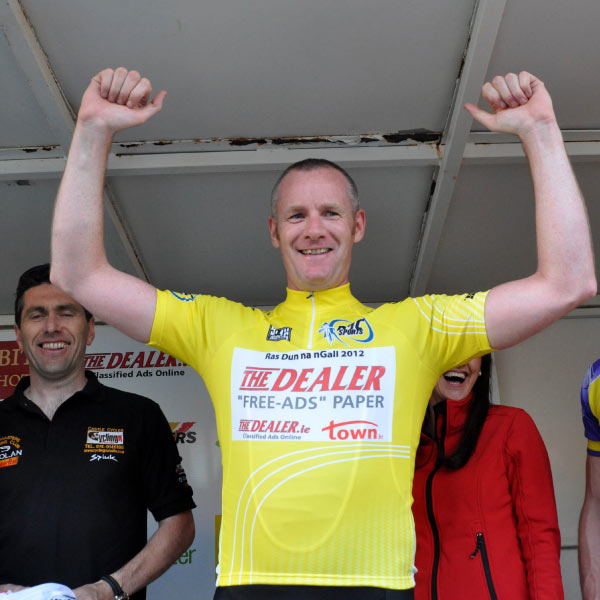 Looking good in yellow; Stewart enjoys his moment on the podium (Photo: Marian Lamb – Cycling Ulster)