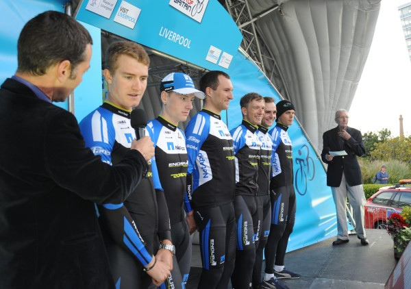 Photo: Bennett, second rider from left, with his NetApp-Endura team being introduced to the Tour of Britain crowd at the start in Liverpool..