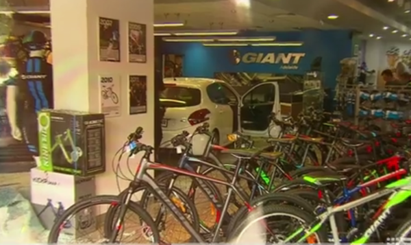 Video car ploughs through Giant bike shop in Adelaide