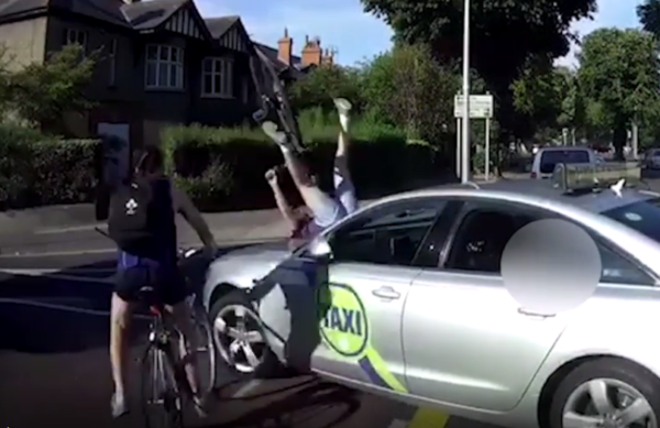 Video cyclists crash up over bonnet of Dublin taxi
