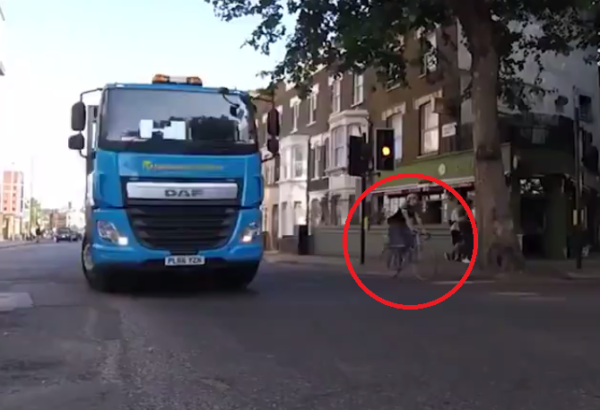 Video truck cyclist turning left